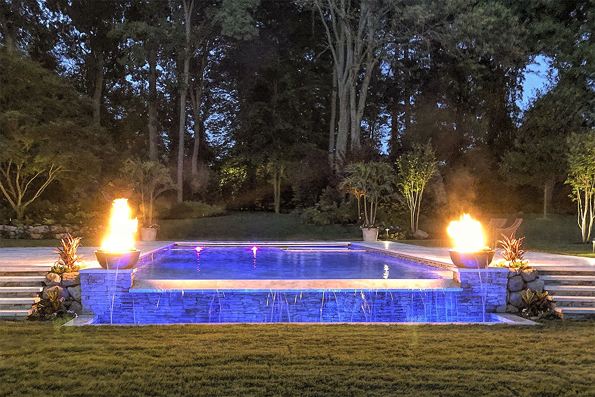 Residential Gunite Pool Construction with Custom Fire-Pit, Sheer Descent, and Auto-Cover Features