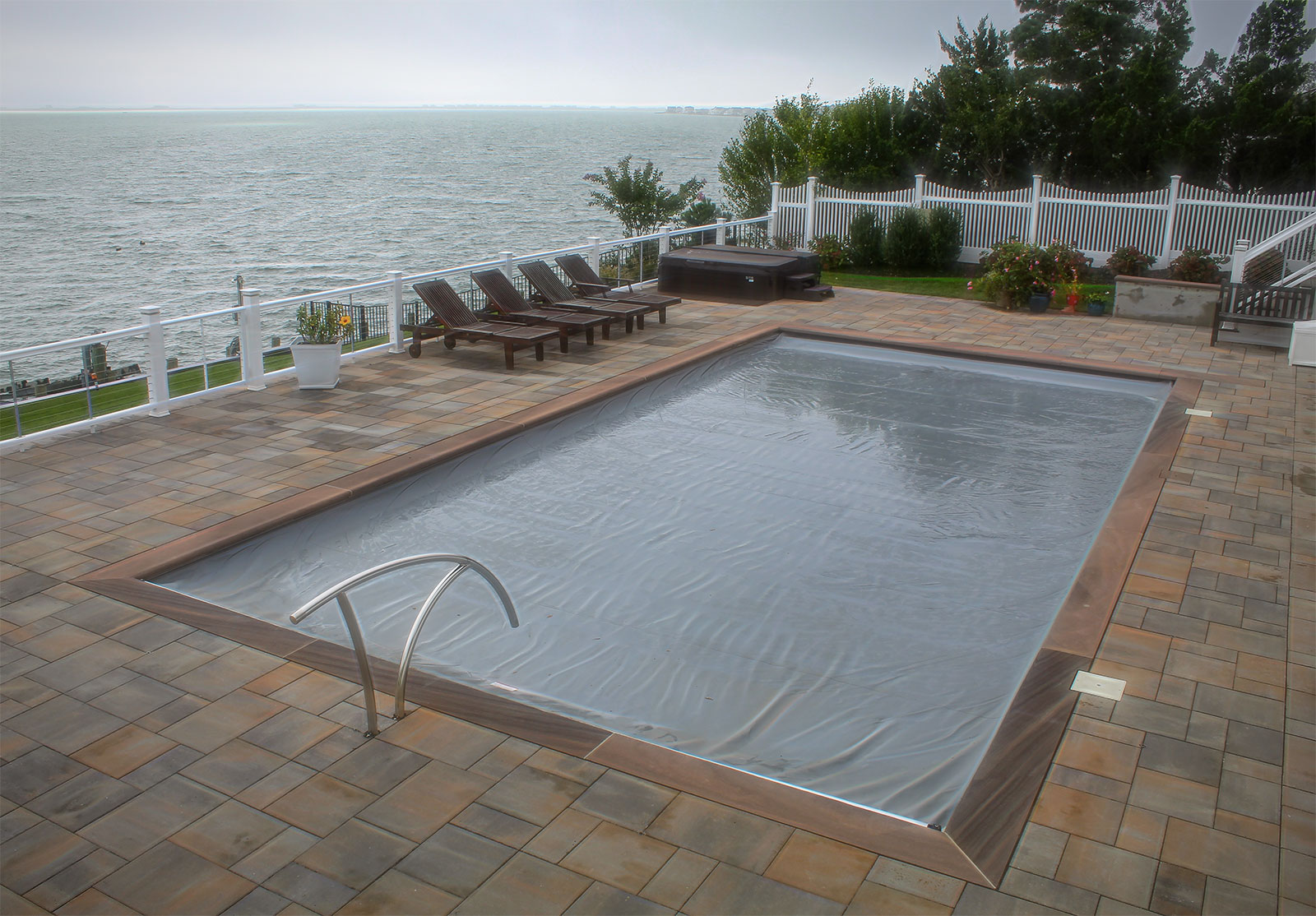 Residential Vinyl Pool Construction with Auto-Cover Feature